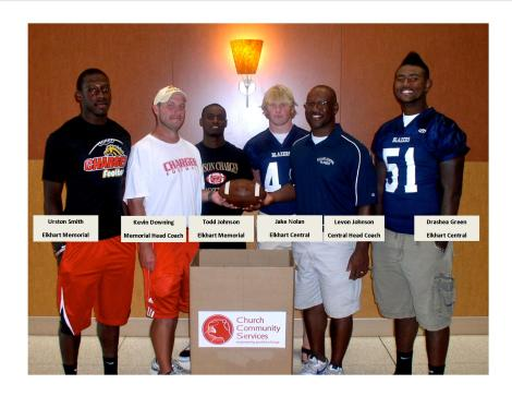 Tackling Hunger: Elkhart Central and Memorial coaches and players